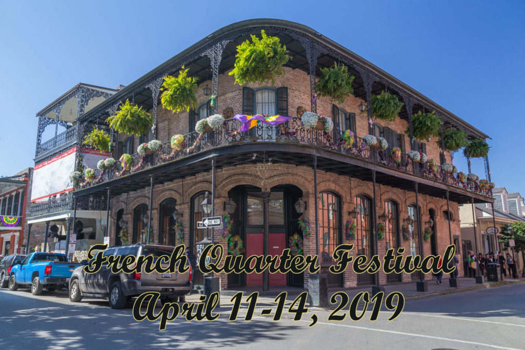 Corner bulding in the French Quarter of New Orleans with iron-work railings